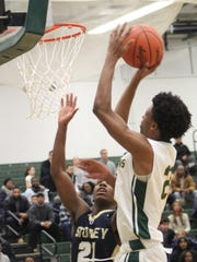 Freshman Daniel Lee (22) rises high for a short jumper