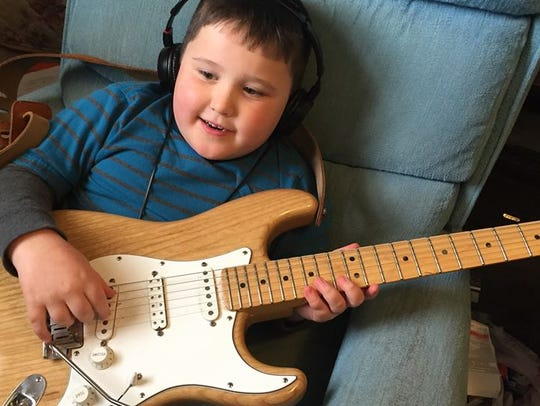 Elijah playing his granddaddy's Stratocaster.