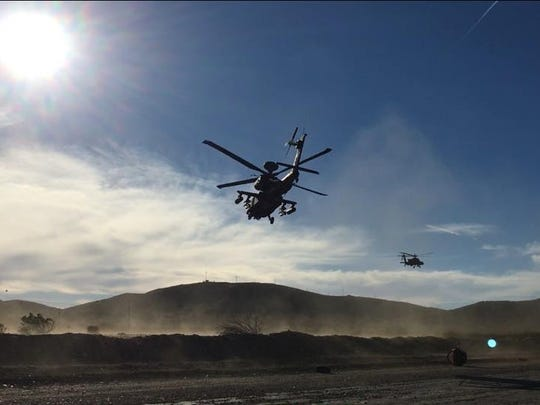 An Apache helicopter with Charlie Troop, 3-6 Cav flies over the training area at Fort Irwin, Calif., during the unit's recent training rotation.