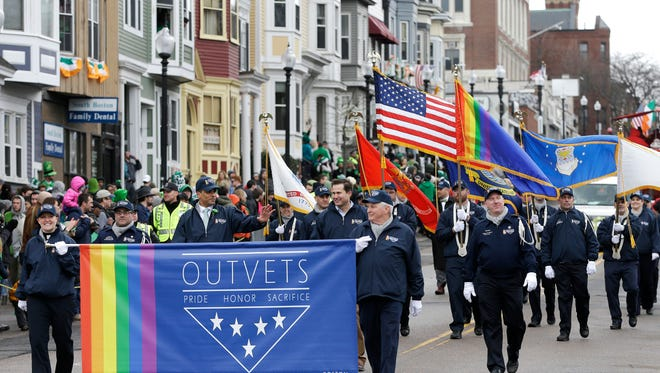 Members of OutVets, a group of gay military veterans, hold a banner and flags as they march in the St. Patrick's Day Parade on March 15, 2015, in Boston. Until now, gay rights groups have been barred by the South Boston Allied War Veterans Council from marching in the parade, which draws as many as a million spectators each year.