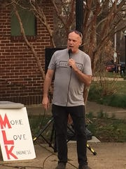 Kevin Melloy speaks at a peace rally held Thursday after two shootings the week before.