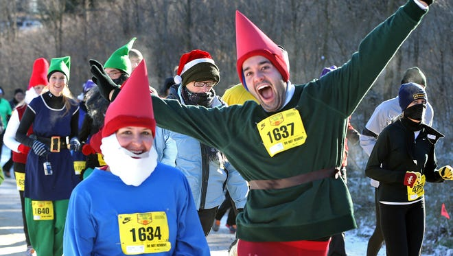 Alexander Courtney, right, was a happy gnome as he ran with Sharon Potanka during the Living History Farms Off Road Race in November.