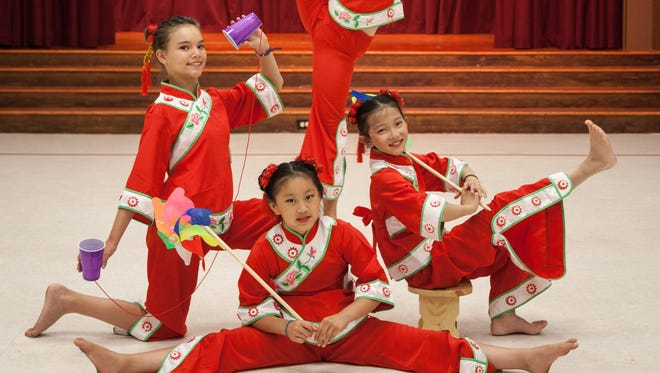 "These four girls perform ""Childhood Memories,"" a new dance for the Chinese American Community Center Folk Dance Troupe. It uses clogs, puppets, pin wheels, stools and cups as props."
