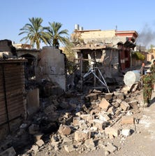 SALADIN, IRAQ - SEPTEMBER 08: Debris of buildings is seen following the recapture of Yengice, Iraq, on September 8, 2014. The areas controlled by the Islamic State of Iraq and the Levant (ISIL) where Turkmens live are one by one being recaptured. Following Suleiman bey and Amirli, Yengice has now also been taken by Peshmerga forces.