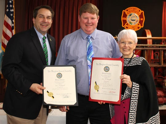 Maryland State Delegate Johnny Mautz (left) and Senator Addie Eckardt (right) award Eric Gosnell (center) for his 25 years of service, earning him a lifetime member title.