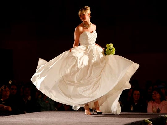 Models strutted their stuff showing off gowns in a