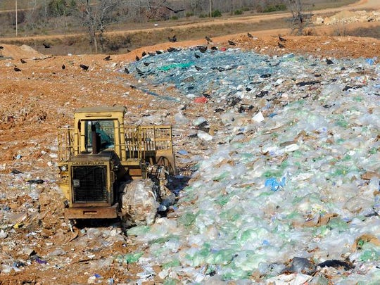 Trash is moved at now-defunct NABORS Landfill in this Nov. 2011 file photo. The never-ending legal saga of the landfill continues with a hearing set for Feb. 6 in Berryville over the collection of an $18 imposed fee to fund repayment of bondholders and cleanup of the site.