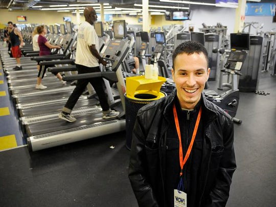 In this 2014 photo, Chris Salas, general manager at Work Out World, talks about how gyms get ready for the new members that will come in with a New Year's resolution to get fit.