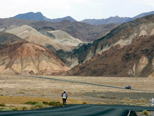 Valmir Nunes, of Brazil, runs in Kiehl's Badwater Ultramarathon in Death Valley, Calif. The race start line was at Badwater, Death Valley, which marks the lowest elevation in the Western Hemisphere at 280 feet below sea level. (AP)