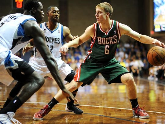 Former SDSU basketball standout Nate Wolters (right) during his NBA days with the Milwaukee Bucks.