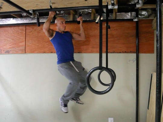 Carl Fantauzzo works out as part of his training in in hopes of being chosen for the coming season of TV series American Ninja Warrior.