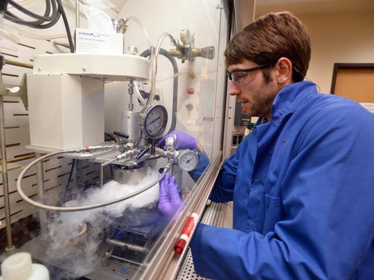 Clemson College of Science and Engineering graduate student Roland Stone distills ethylene oxide into a reactor at the Clemson University Advanced Materials Research Laboratory as part of research into creating advanced cancer fighting materials in this USA Today network file photo.