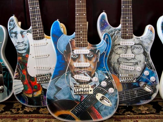 Kurt Kiehnle makes a series of rock and roll heroes guitars wrapped with the artwork of local folk artist Lennie Jones.