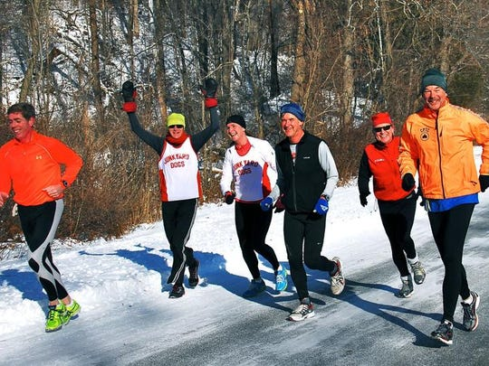 Runners are shown participating in the Recover From the Holidays 50K in this file photo. Running outdoors in the cold can be invigorating, but running on ice can be dangerous.