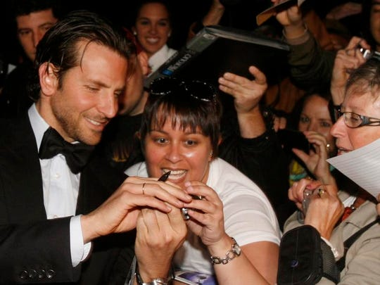 Actor Bradley Cooper greets fans at the 2013 Palm Springs International Film Festival awards gala at the Palm Springs Convention Center.