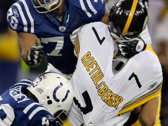 Indy's Raheem Brock and Dwight Freeney put the squeeze on Pittsburgh's Ben Roethlisberger. The Indianapolis Colts hosted the Pittsburgh Steelers for Monday Night Football at the RCA Dome in Indianapolis, IN on Monday, November 28, 2005. The Colts won the game 26-7.