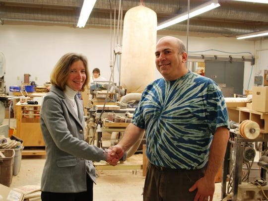Flex Fund President Janice St. Onge and business owner David Glickman in his new Vermont Butcher Block & Board Company manufacturing shop on Boyer Circle in Williston on Dec. 10.