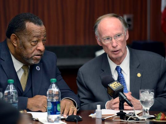 Alabama State University board of trustees Chairman Elton Dean, left, talks with Gov. Robert Bentley before the trustees' meeting Friday.