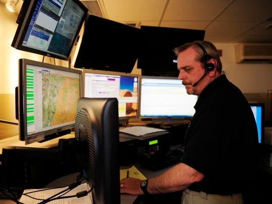 Jim Shade, a 911 operator at the Williamson County Emergency Communications Center, responds to a call.