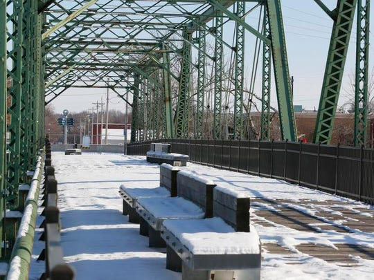 The Jackson Street Bridge, a pedestrian bridge that spans the Raccoon River south of downtown Des Moines, reopened in 2016.