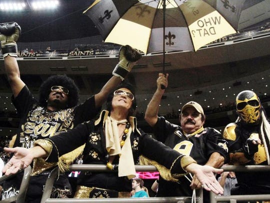 New Orleans Saints fans celebrate during a game against the Miami Dolphins at the Mercedes-Benz Superdome in New Orleans.