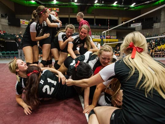 Hurricane players celebrate after winning the 3A state volleyball championship Nov. 2, 2013, at Utah Valley University.