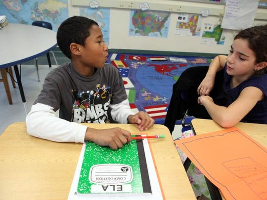 From left, Isaiah Santiago and Kathryn Petlyuk, are seen in 2012 while in fourth grade, having a discussion about the story they read during an English Language Arts lesson at King Street Elementary School in Port Chester. They were preparing for the new Common Core-aligned state assessment tests.