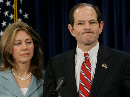 Then-Gov. Eliot Spitzer joined by his wife, Silda, as he addressed reporters at a news conference March 10, 2008, during his prostitution scandal. (AP Photo/Mary Altaffer)
