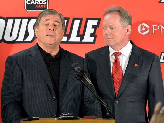 Tom Jurich and Bobby Petrino stand during Petrino's 2014 introductory press conference.