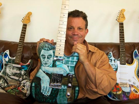 Kurt Kiehnle is shown with his series of rock and roll heroes guitars. He donates many of his handmade guitars to charities for silent auctions.