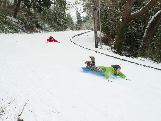 Silverton brothers Ezra Westgate, 12, front, and Noah Westgate, 13, took advantage of Silverton's Danger Hill being blocked to traffic in 2014.
