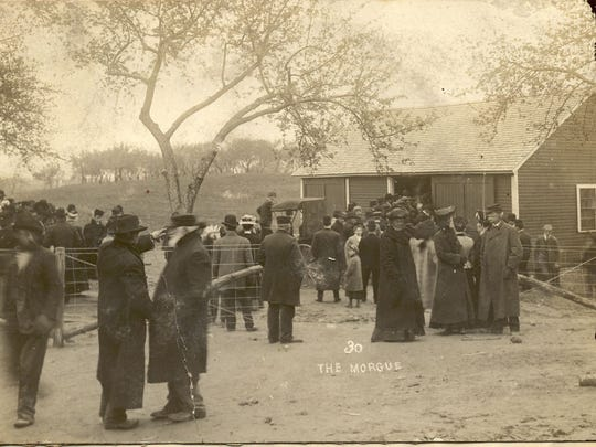 Photo shows the scene at Belle Gunness' farm in LaPorte, Ind., when large crowds came to watch bodies being pulled out of the ground.