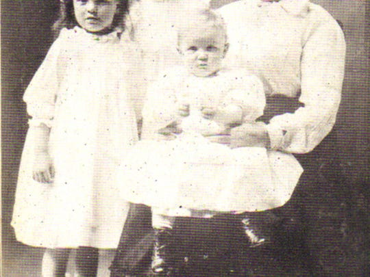 Belle Gunness is pictured with her kids: Lucy and Myrtle Sorneson (from her first marriage) and Phillip Gunness (from her second marriage)