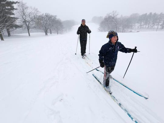 Cooper Michael, 9, leads his father, Bryan Michael of Des Moines while the two cross country ski Tuesday, February 4, 2014 at Waveland Golf Course in Des Moines.