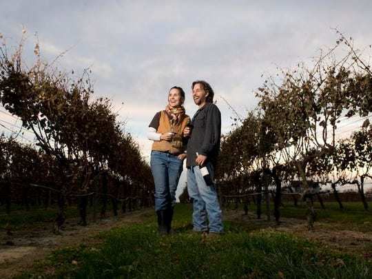 Scott and Julianne Donnini stand in vineyard at their winery, Auburn Road Vineyard & Winery, in Pilesgrove. The winery hosts 'LIVE! From the Vineyard Stage' concerts, including one on Saturday.