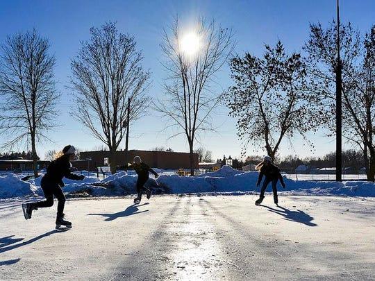 Skaters brave sub-zero temperatures at the Pleasantview skating rink in Sauk Rapids in January 2014.