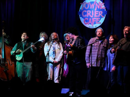 Dave Bernz, second from left, is joined by friends at the open mic dedicated to Pete Seeger at the Towne Crier Cafe on Wednesday.
