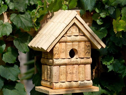 Wine corks make a bird house.