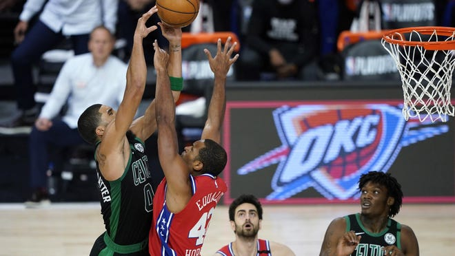 The Celtics' Jayson Tatum goes up for a shot as the 76ers' Al Horford defends during Monday night's first-round playoff game.
