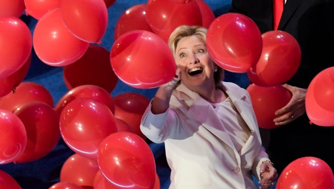 Democratic presidential nominee Hillary Clinton watches as balloons drop during the 2016 Democratic National Convention at Wells Fargo Center.