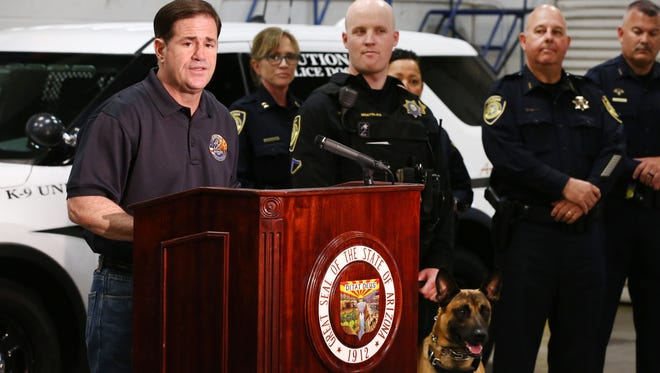Arizona Gov. Doug Ducey welcomes ADOT's Enforcement and Compliance Division's first K-9 units, which detect illegal drugs and human smuggling, on July 6, 2018, at the Transportation Department office in Phoenix.