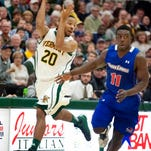 Vermont's Dre Wills (center) steals the ball from UMass-Lowell's Akeem Williams and Antonio Bivins.Wills' role has increased in the last two games.