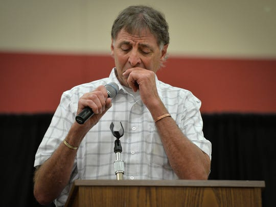 Bob Theisen breaks down as he talks about his brother,
