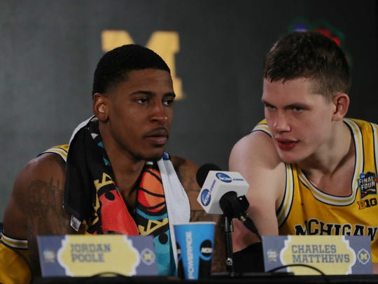 Charles Matthews, left, and Moritz Wagner speak to the media after Michigan's 69-57 victory over Loyola-Chicago in the NCAA men's  semifinal.