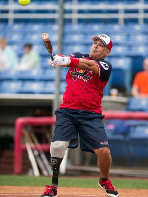 Ben Mitchell of the Wounded Warrior Amputee Softball Team takes a cut during Saturday's game.
