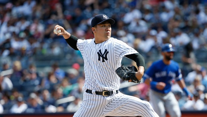 New York Yankees' starting pitcher Masahiro Tanaka (19) delivers in the fifth inning of a baseball game against the Toronto Blue Jays in New York, Monday, Sept. 5, 2016.