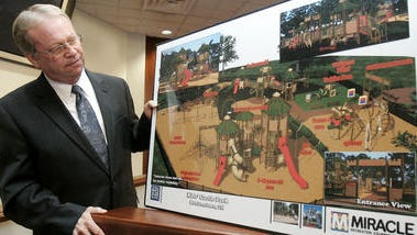 Murfreesboro Parks and Recreation Director Lanny Goodwin looks at a rendering of the new Kids Castle that will replace the present one that is located at Old Fort Park.