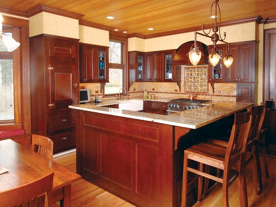 Hiding the appliances and combining two adjacent spaces helped open up the kitchen for current entertaining needs.