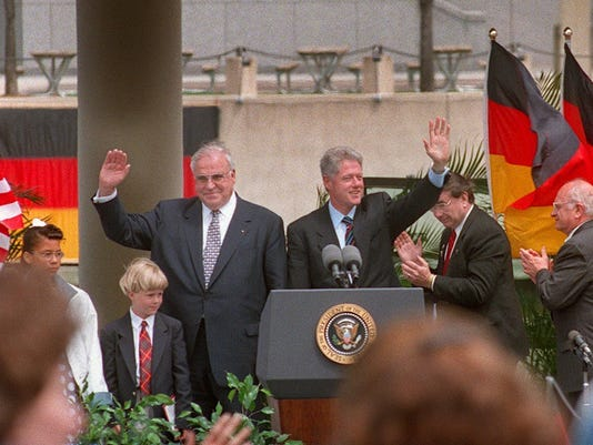 Bill Clinton & Helmut Kohl waving to the crowd in Milwaukee