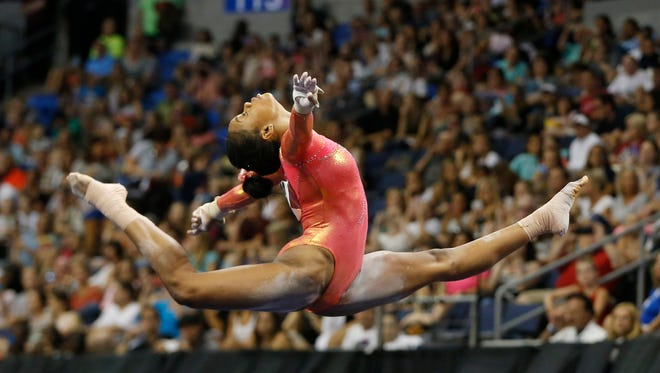 Olympic gold medalist Gabby Douglas performs her floor routine Friday, June 24, 2016, during the P&G Gymnastics Championships at Chaifetz Arena in St. Louis.